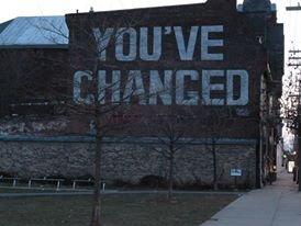 painted sign on building with youve-changed